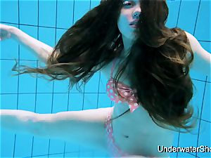 fabulous gal flashes mind-blowing assets underwater