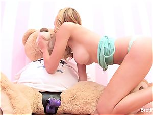 Brett Rossi plays with a plunged bear's strap-on fuck stick