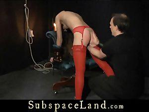 Tina Blade arse flogged in sensuous crimson undergarments
