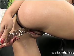 big-titted Elena Rae pisses through her pantyhose
