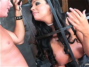 encaged dark-haired sucks cock and receives hard humping