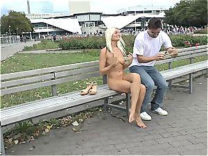 blond Czech nubile demonstrating her torrid body bare in public