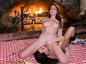 lesbos pleased by the fireplace