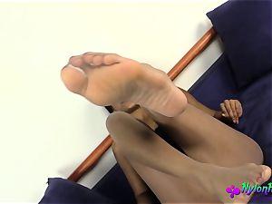 Janelle Poses in stellar Nylon stockings