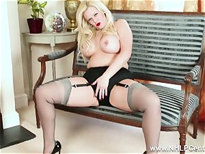 curvaceous platinum-blonde milks in grey nylons and high stilettos